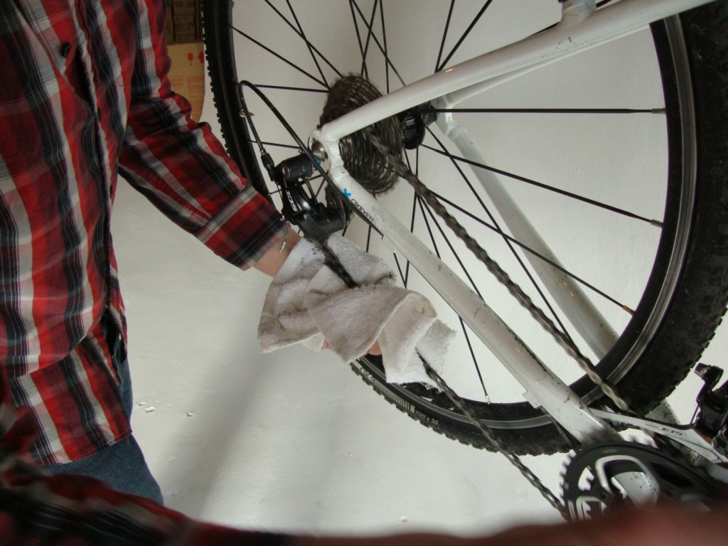 Wiping off the excess lube after lubing your chain