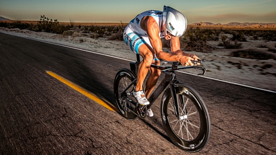 Guy racing on a trek speed concept triathlon bike